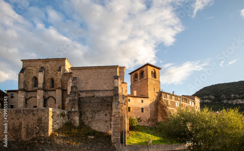 View of the tower and the rear wall of San Juan Bautista church in the small tow Canvas Print