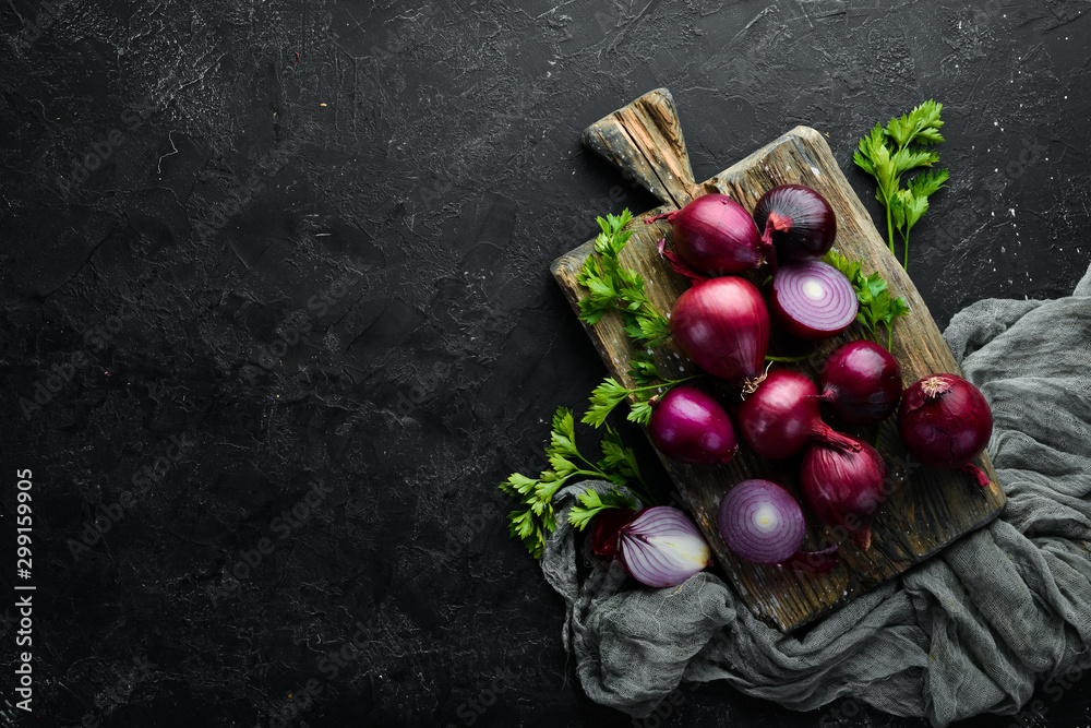Fototapety, obrazy: Fresh red onions on black background. Top view. Free copy space.