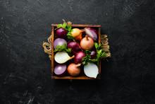 Fresh Ripe Onions In Wooden Bo...