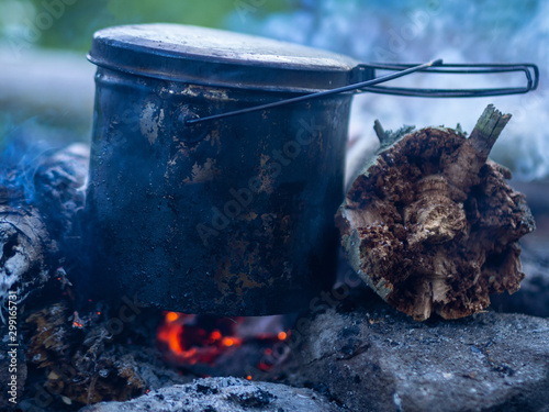 Fotografie, Obraz Bowler Sasha at the stake, Cooking food at the stake outdoors scene