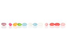 Lot Of Whole Jelly Bean Candy In Line Isolated On White Background