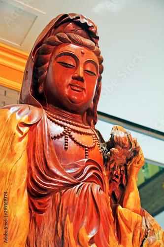 Photo Bodhisattva wood carving