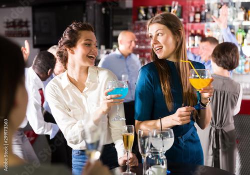 Girls funning on firms party Fototapeta