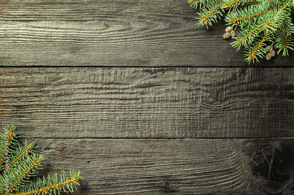 Fototapety, obrazy: Christmas fir tree branches and pine cones on wooden dark, black background.