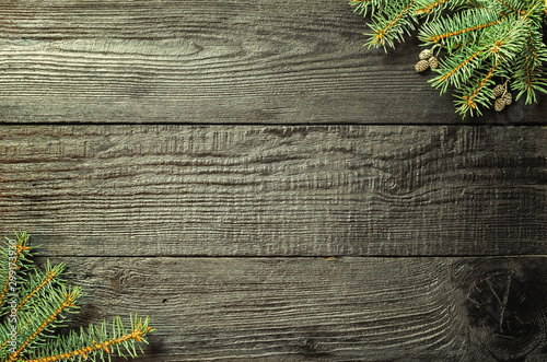 Pinturas sobre lienzo  Christmas fir tree branches and pine cones on wooden dark, black background