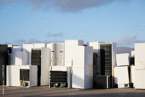Old fridges freezers refrigerant gas at refuse dump skip recycle stacked pile pl Canvas Print