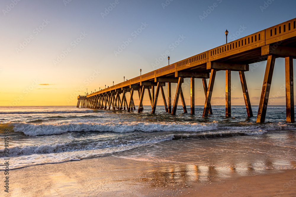 Fototapeta Johnnie Mercers Fishing Pier at sunrise in Wrightsville Beach east of Wilmington,North Carolina,United State.