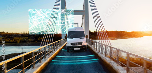 Foto auf AluDibond Logo Autonomous transporter Car driving on a bridge highway with technology assistant tracking information, showing details.