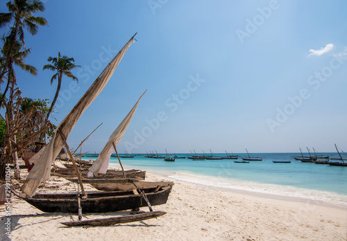 Foto auf Gartenposter Sansibar Traditional wooden sailing boats in Africa. Dhow on a beach on the shores of the Indian Ocean in northern Zanzibar.