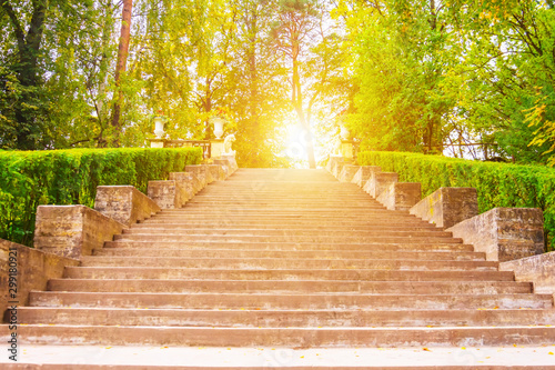 Wide staircase looking up in the park with bright light. Fototapet