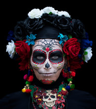 Girl In Carnival Mask For A Traditional Mexican Holiday Of The Day Of The Dead On A Contrasting Black Background
