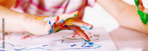 Obraz Close up young girl painting with colorful hands. Art,  creativity and painting concept. Horizontal image. - fototapety do salonu