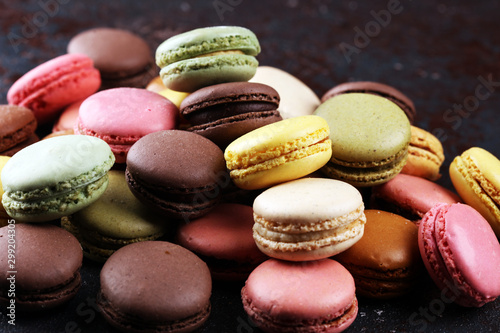 Canvas Prints Macarons Sweet and colourful french macaroons or macaron on dark black background, Dessert.
