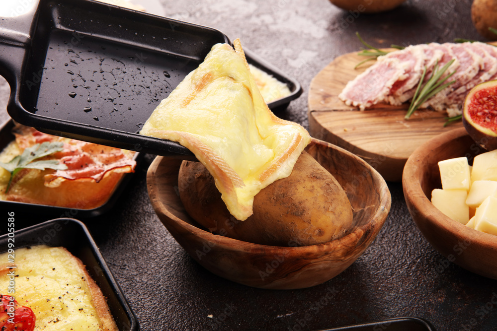 Fototapety, obrazy: Delicious traditional Swiss melted raclette cheese on diced boiled or baked potato.