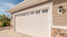 Panorama Frame Double Garage Of Modern Home On Sunny, Clear Day