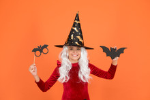 Boo To You. Little Wicked Witch Orange Background. Small Child Wear Witch Costume For Holiday Celebration. Halloween Celebration. Photobooth For Holiday Celebration. All Saints Day Celebration