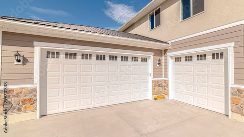 Fotografia, Obraz Panorama frame Drive way and garage of modern two storey home