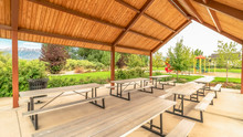 Panorama Frame Focus Inside The Pavilion Of A Park With Tables And Seats Under Brown Ceiling