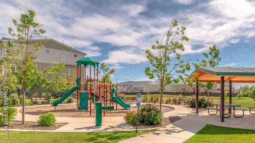 Photo Panorama Park at a sunny neighborhood with childrens playground and pavilion eat