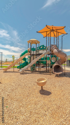 Fotografia, Obraz Vertical Outdoor playground on sunny day with no people