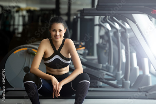 Asian slim Fitness woman black hair sport bra white shoe exercise warm up and sit tired on Treadmill in Fit Gym. Concept female Can Do athlete Sport healthy, copy space