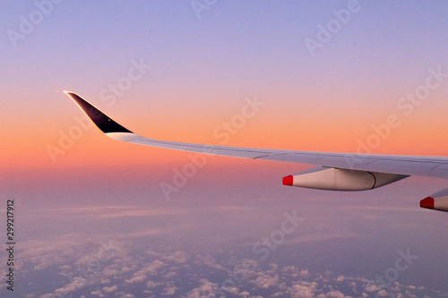 Fototapeta  Sky - OCTOBER 16, 2019:  Landscape sunrise view with clouds from Singapore Airli