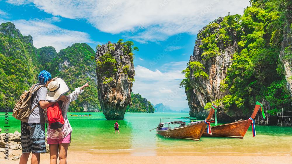 Fototapeta Couple traveler joy nature scenic landscape James Bond Island Attraction famous landmark tourist travel Phuket Thailand fun beach summer outdoor vacation trip, Tourism beautiful destination place Asia
