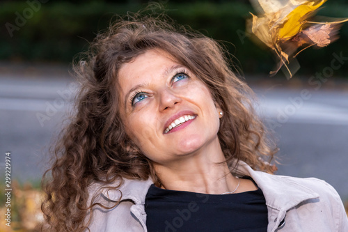 Fototapety, obrazy: portrait of a young woman,she is looking up and smiles
