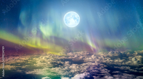 Poster Aurore polaire Northern lights (Aurora borealis) in the sky over clouds with full moon