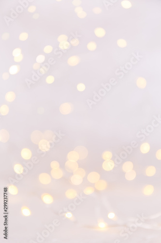 Fototapety, obrazy: White background with bokeh lights. Holiday Christmas and New Year background. Vertical