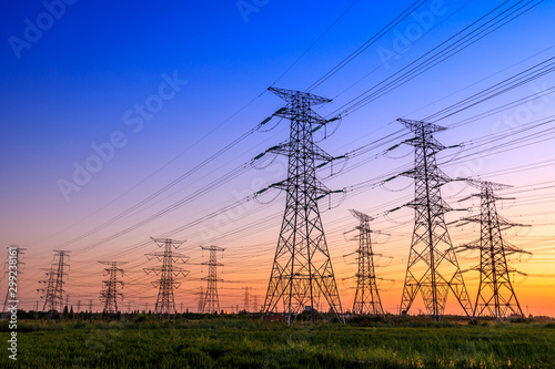 Leinwand Poster High voltage electricity tower sky sunset landscape,industrial background