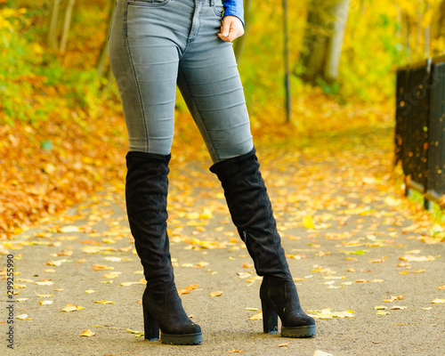 Foto op Canvas Wild West Woman wearing black knee high boots