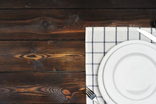 Table Setup With Plates On Dark Wooden Background