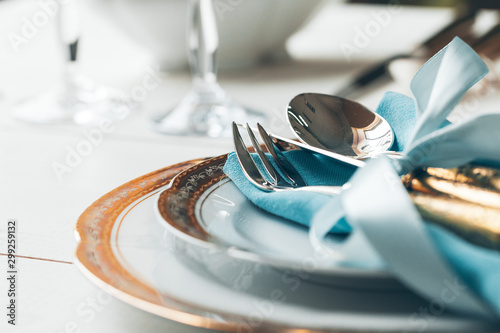 Obraz na plátně Close up shot of table setting for fine dining with cutlery and glassware