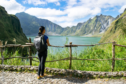 Obraz na plátne Young Asian girl stands alone at overlook near crater of Mount Pinatubo, gazing