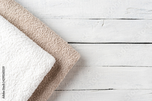 Clean folded towels on white wooden table with copyspace Obraz na płótnie