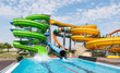 canvas print picture - Water park with colorful slides and pools