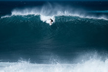 Surfer Rides Giant Wave At The Famous Banzai Pipeline Surf Spot Located On The North Shore Of Oahu In Hawaii