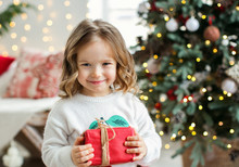 Little Girl With Chritmas Present.