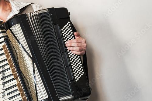 Valokuva  Accordionist plays vintage accordion