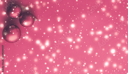 Christmas baubles on pink background with snow glitter, luxury winter holiday card - 299289307