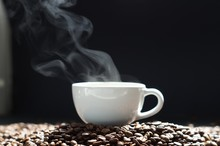 A Cup Of Hot Coffee With Steam...
