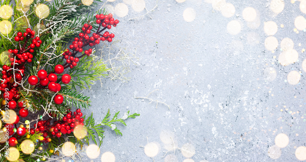 Fototapety, obrazy: Christmas or winter background with a border of green and frosted evergreen branches and red berries on a grey vintage board. Flat lay