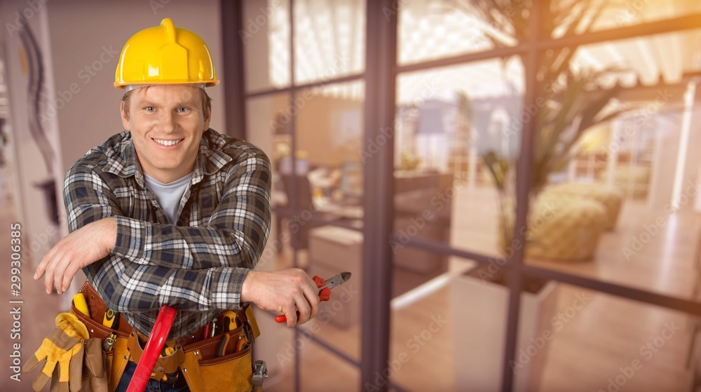 Fototapety, obrazy: Construction worker with tools in empty building
