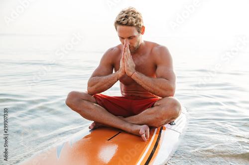 Spoed Fotobehang Wanddecoratie met eigen foto Handsome young man surfer with surfing desk at the beach