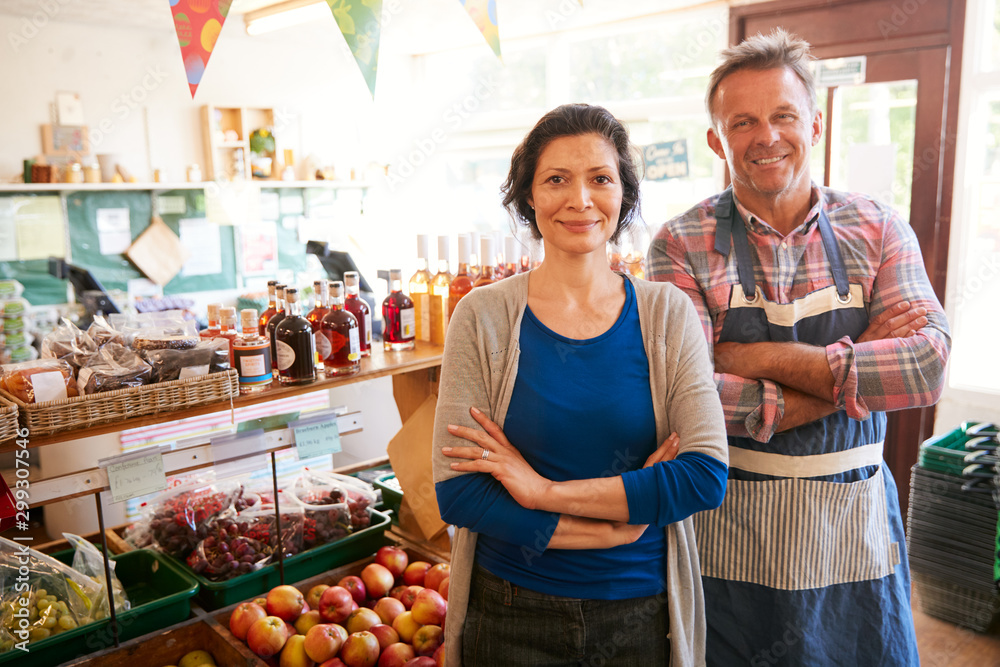Fototapety, obrazy: Portrait Of Mature Couple Running Organic Farm Shop Together