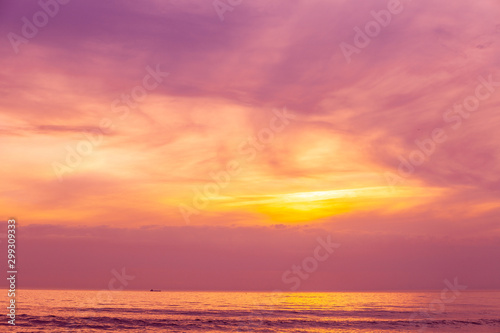 Sunset over the sea. Atlantic ocean in the evening. Beautiful sunset with dramatic sky