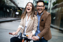 Happy Young Couple Riding On B...