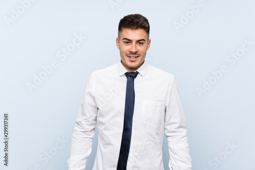 Fototapety, obrazy: Handsome businessman over isolated blue background with surprise facial expression