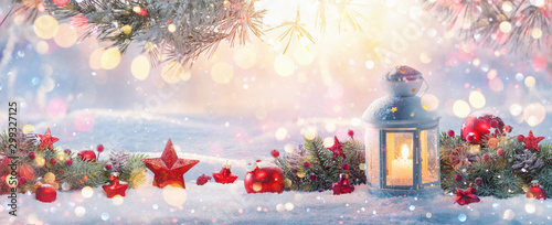 Foto auf Gartenposter Individuell Christmas Lantern On Snow With Fir Branch in the Sunlight